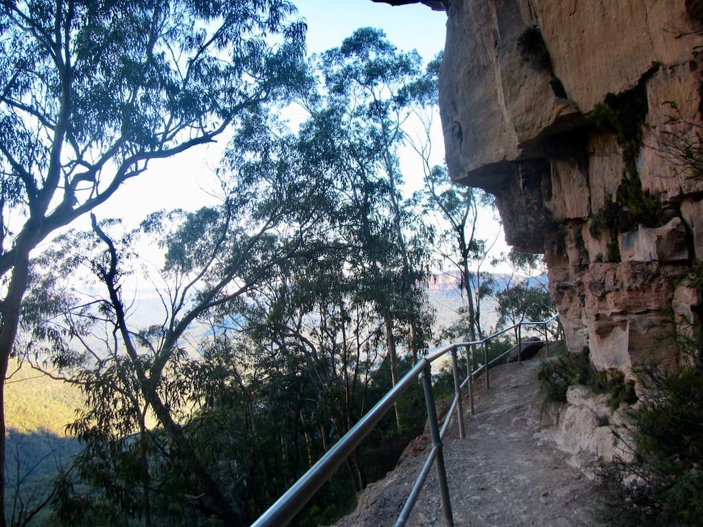 Narrow cliffside trail in Katoomba hugging the rock face in the Blue Mountains, Australia