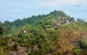 Taal volcano ridge | Taal caldera lake | Sheds and shelters along a volcano slope | the Philippines