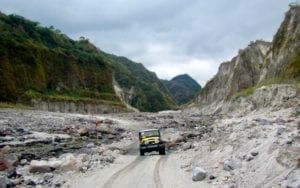 Yellow jeep crossing through the ravines | Mount Pinatubo trail to the caldera lake | the Philippines