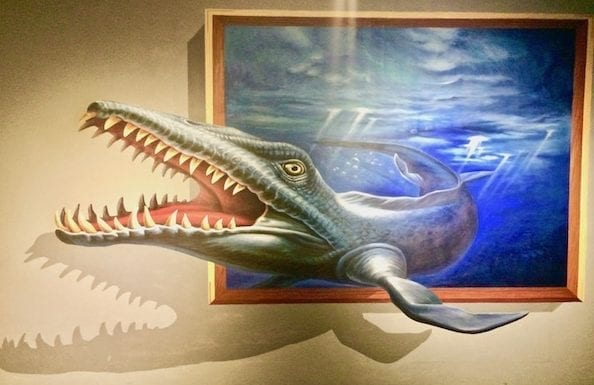 3D art of a sea monster bursting out of a wall painting