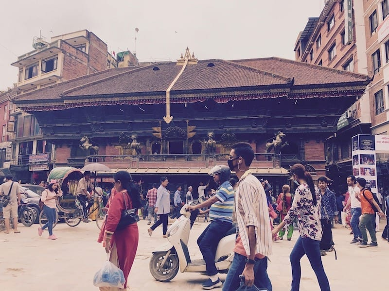 Temple to Shiva on a busy Kathmandu street | header image for Nepal basic logistics article on the travel blog Teja on the Horizon | Nepal Travel Logistics: What It Costs If You Can't Be Bothered |Nepal travel | Nepal logistics cost | Nepal taxi rates | Nepal mobile data service