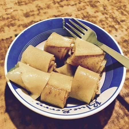Small meal of laphing, rolls of pastry sheets served with spicy sauce | halal food Nepal | Tibetan street food | Muslim traveler | halal travel | Nepal Travel Logistics: What It Costs If You Can't Be Bothered on travel blog Teja on the Horizon
