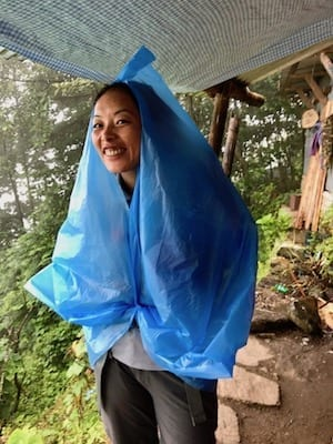 Nepal local rain solution | Annapurna rain poncho | Annapurna in the Monsoon Day 2: At the Brink of Fog and Cloud | Ulleri to Ghorepani | ABC trekking in monsoon | Annapurna Circuit in the off season | Nepal hiking | female trekking guide Nepal | Nepal outdoors | women trekking | Asian female trekking | Teja on the Horizon
