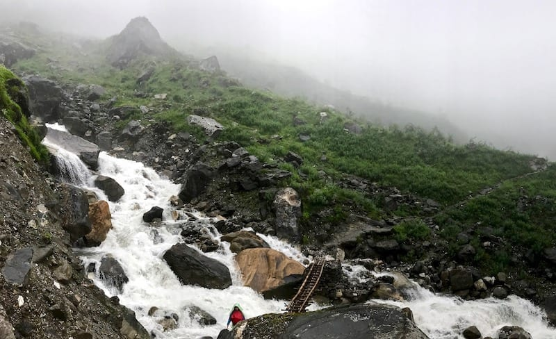 Annapurna in the Monsoon Day 6: The Shrine of Dovan | nepal temple in Annapurna Sanctuary | waterfalls, streams, rapids, and river crossings during Annapurna trekking | strawberries in Annapurna | altitude sickness Nepal hiking | ABC trek | Asian female trekking | Teja on the Horizon