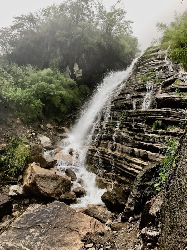 Fording the waterfall to Deurali | Annapurna in the Monsoon Day 6: The Shrine of Dovan | waterfalls, streams, rapids, and river crossings during Annapurna trekking | ABC trek | Asian female trekking | Teja on the Horizon