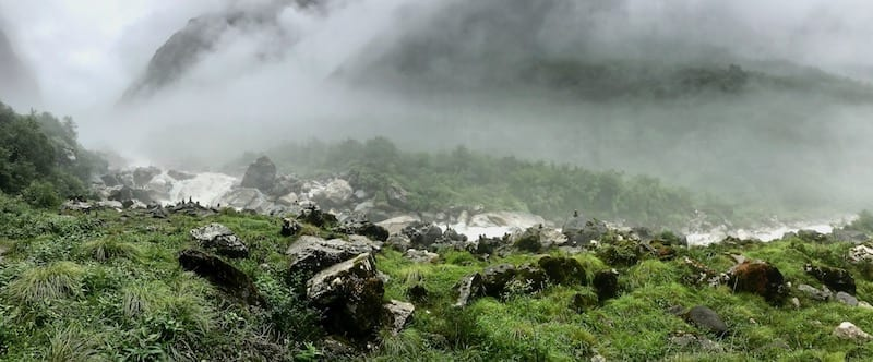 Mist and spray over a monsoonal alpine stream | Annapurna in the Monsoon Day 7: To the Base Camp on a Trail of Flowers | Annapurna Base Camp trek | Annapurna Sanctuary trek | Asian female trekking | Teja on the Horizon