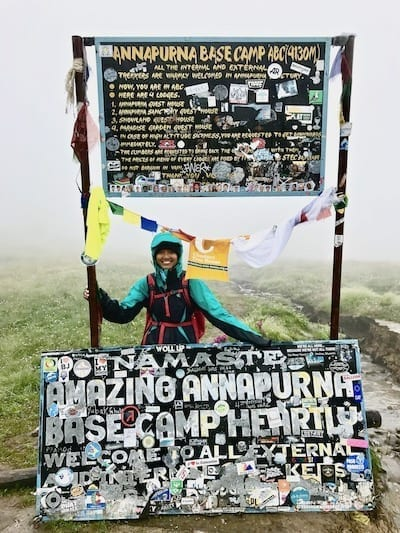 Annapurna Base Camp sign | Annapurna in the Monsoon Day 7: To the Base Camp on a Trail of Flowers | Annapurna Base Camp trek | Annapurna Sanctuary trek | Asian female trekking | Teja on the Horizon