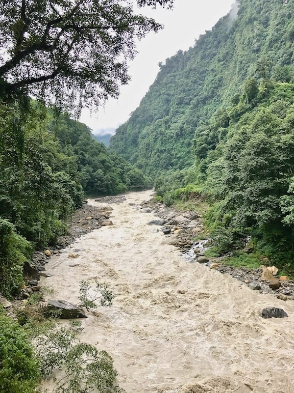 River Modi Annapurna tributary | Annapurna in the Monsoon Day 10: Trekking Tips for the Newbie Trekker | trekking guide | slow trekking | sustainable hiking | Nepal monsoon trekking tips | Asian female trekking | Teja on the Horizon