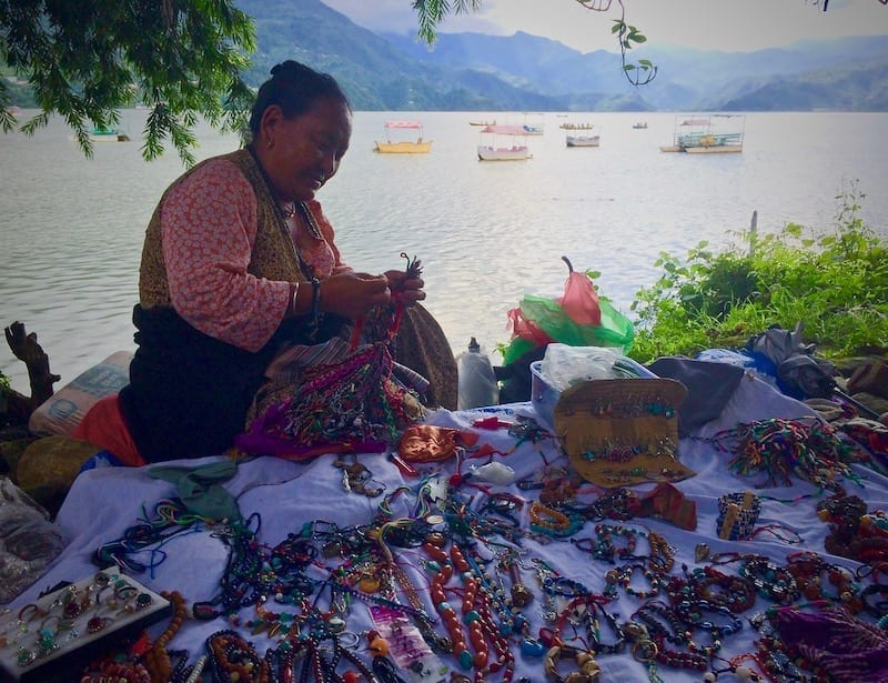 Tibetan jewelry hawker by Lake Phewa, Pokhara | sustainable travel | travel sustainability review | Travel Sustainably Nepal edition How I Tried to Travel Responsibly | Teja on the Horizon