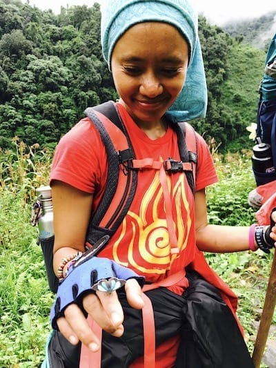Iridescent blue butterfly perched on finger | Annapurna in the Monsoon Day 10: Trekking Tips for the Newbie Trekker | slow trekking | Nepal butterflies in the mountains | Asian female trekking | Teja on the Horizon