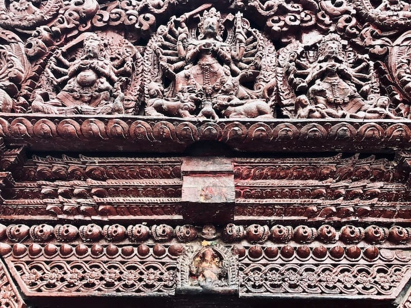 Kali goddess relief carvings over a portal at the house of the royal Kumari | Hinduism in Nepal | virgin worship | child goddess Kumari | A Kumari Contemplates Kathmandu Durbar Square | Teja on the Horizon