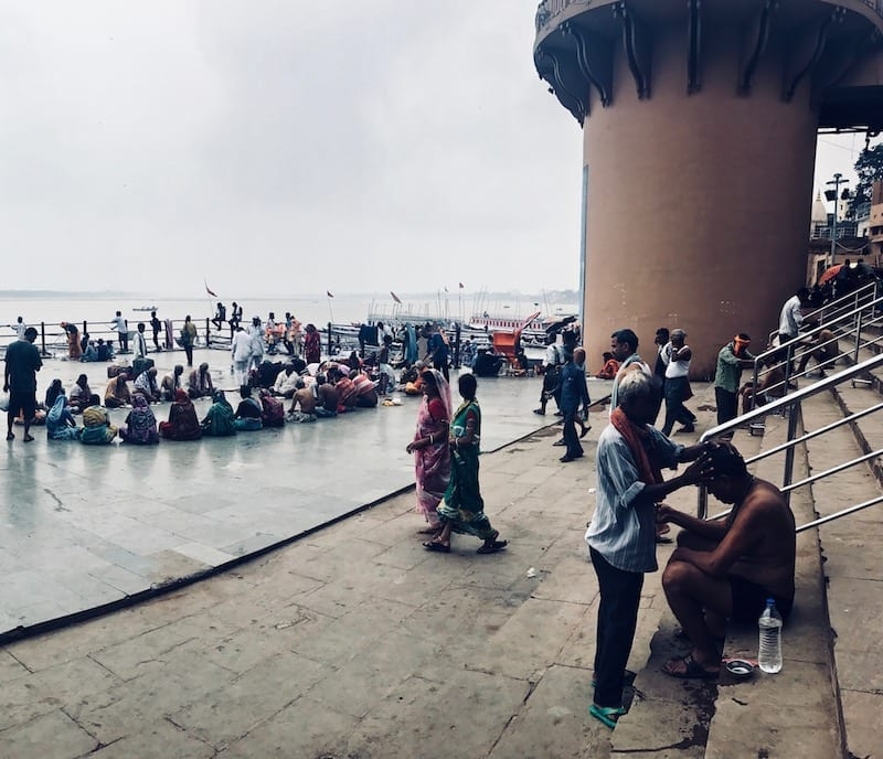 A view out onto Dashashwamedh Ghat in Varanasi, India | Hindu pilgrimage to Ganges | Worshippers at a Benaras ghat | Varanasi day tour
