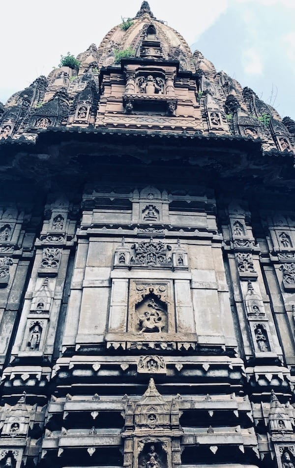 Hindu temple facade with carved stone near Manikarnika Ghat, Varanasi | Hinduism in India | Benaras temples