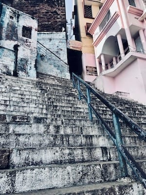 Steps of a Varanasi ghat looking up into the warren of alleys of the old city | Ghats of Benaras | Ghat leading down to Ganges River | Walking up the ghat on a Varanasi day tour
