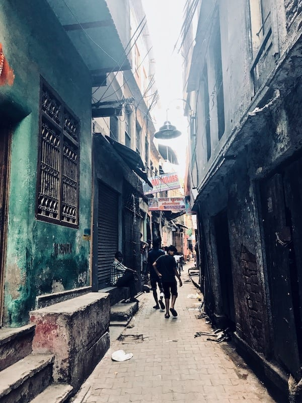A view down a narrow Varanasi alley in the old part of Kashi | Benaras warren city | ancient Shiva city
