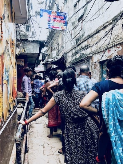 Queue of Hindu worshippers lining up to observe a festival at Kashi Vishwanath temple in Varanasi, India | Crowded alleyways of Benaras on a holy day