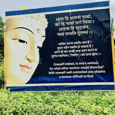 Placard by the paths within Sarnath temple precincts, quoting Buddhist teachings