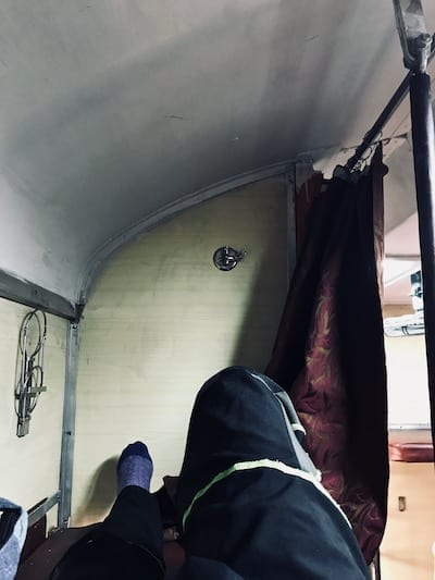 View of the space of the aisle side top bunk in a Second Class Air Conditioned carriage in an Indian train