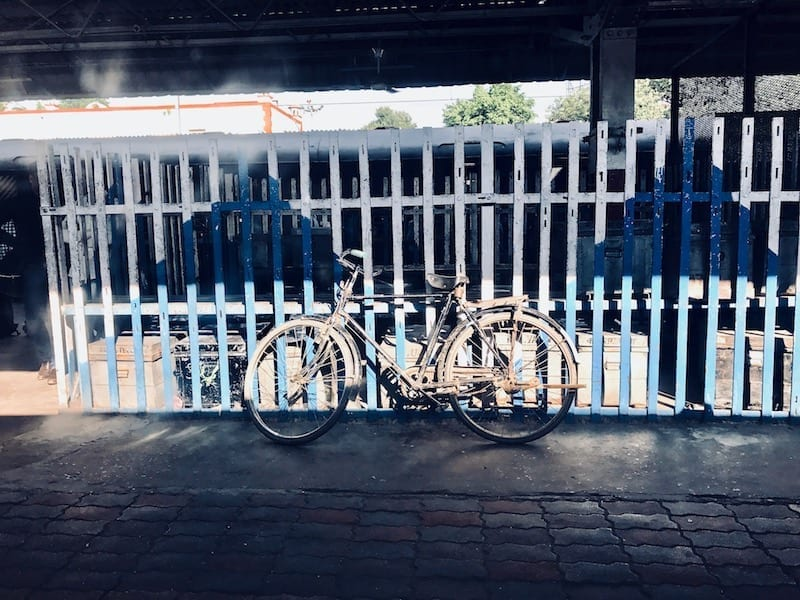 Bicycle at Indian railway covered platform in Uttar Pradesh