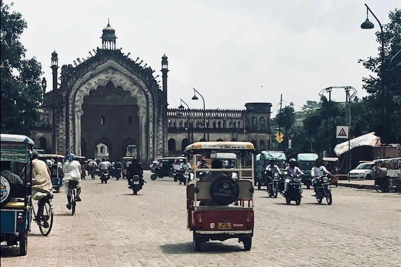 Motorcycle and tuktuk traffic in old Lucknow near Rumi Darwaza