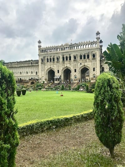 View across the Bara Imambara courtyard towards the grand archway facade into the imambara compound | Uttar Pradesh must see Lucknow attraction