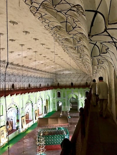 Labyrinth of Bara Imambara emerges onto a gallery overlooking the central hall where the Nawab who built it lies entombed | Green-walled imambara hall and tomb of Asad ud-Daula | Uttar Pradesh heritage