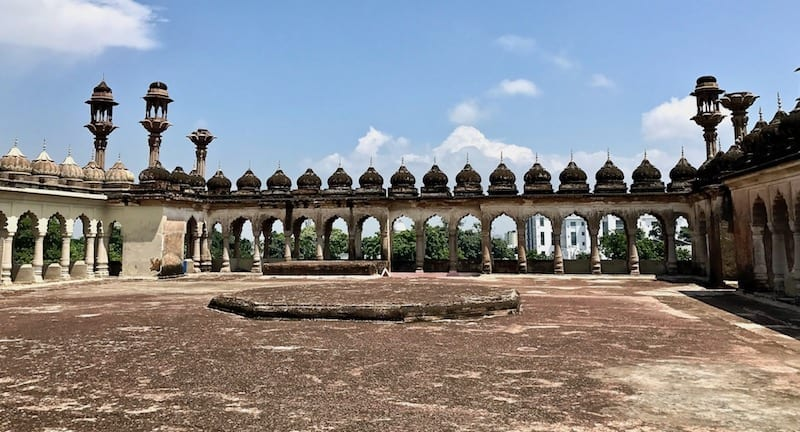 Rooftop view of the line of arches forming the parapets of Bara Imambara in Lucknow, India | Uttar Pradesh heritage monument