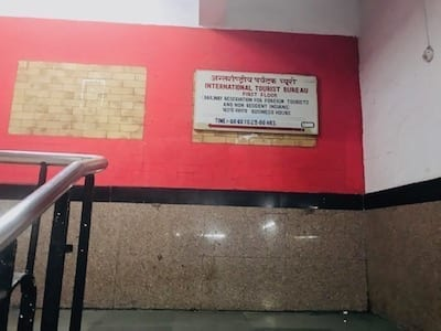 What the signage looks like to go to the International Tourist Bureau in New Delhi Train Station near Platform 1 at the Pahar Ganj side | Getting train tickets from Delhi to Agra to see the Taj Mahal