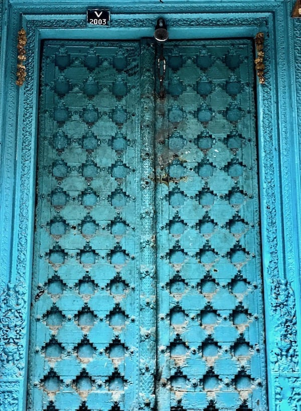 Old blue door in Delhi with repeating recessed diamond pattern | Delhi walking tour