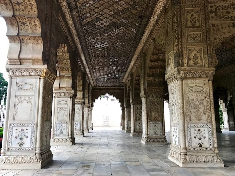 A view down the rows of columns of the special audience hall made of intricately inlaid and carved white marble, where the Mughal emperor would hold audiences with eminent persons | Red Fort of Delhi Shahjahanabad | UNESCO Heritage Site
