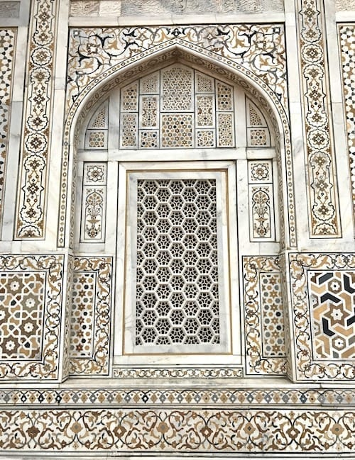 Window of latticed marble surrounded by Mughal pietra dura marble inlay craft on the Baby Taj (Tomb of I'timad ud-Daula) in Agra, India | Tomb built by Nur Jahan, badass Mughal empress