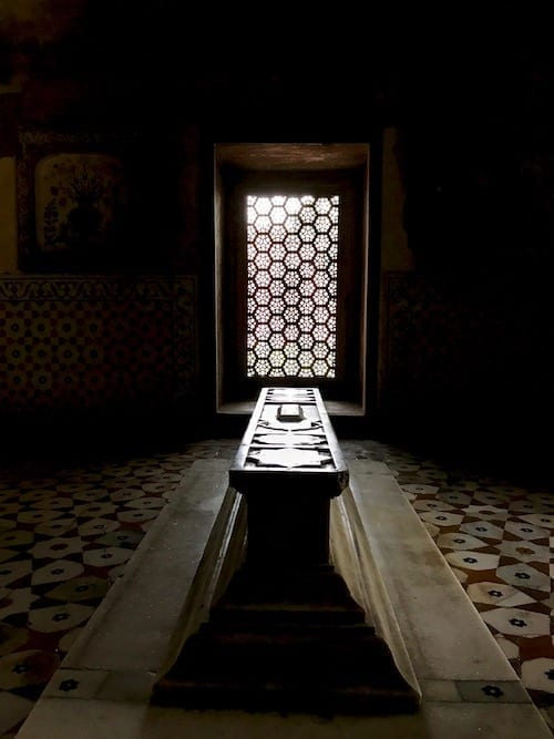 View of a tomb marker in a dark space within the Baby Taj, with light spilling upon it through the latticed marble window | Mughal tomb and marble craftsmanship | Empress Nur Jahan family tomb