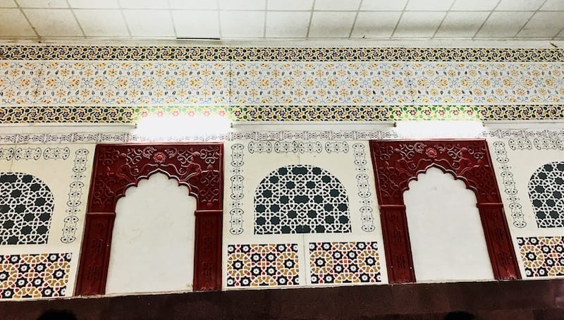 Decorative Mughal style mosaics on the upper walls of Agra train station