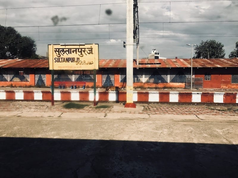 Sultanpur sign on an open air railway platform in North India | Train travel across Uttar Pradesh leaving Varanasi for Lucknow