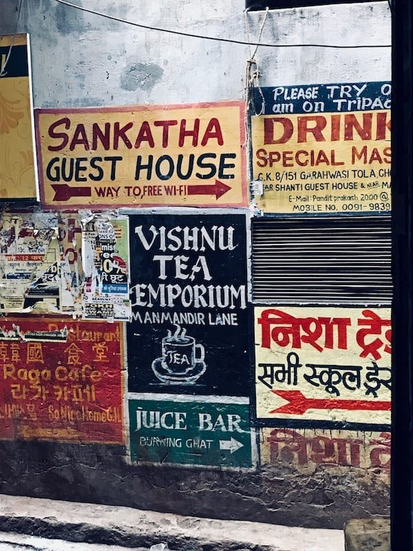 Signage in Varanasi alley in front of the Blue Lassi shop