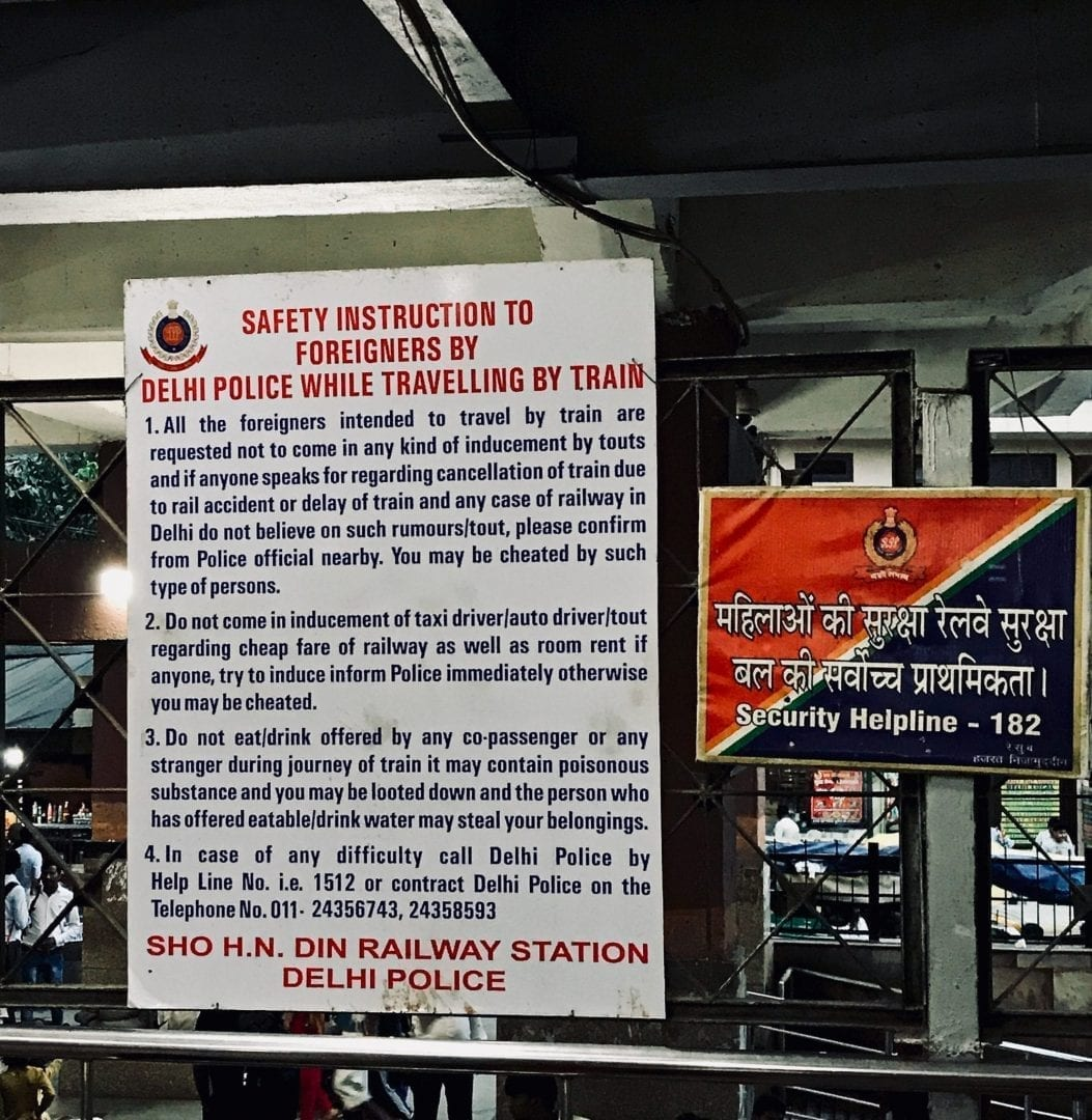 Detailed sign by Delhi Police in Delhi train station warning travellers against scams