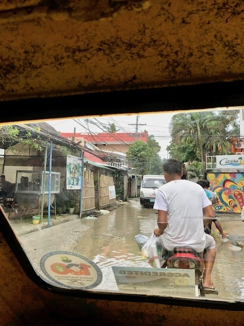 A view out of the tuktuk of an ordinary street on Boracay Island | The less enchanting, 'real' side of Boracay Island
