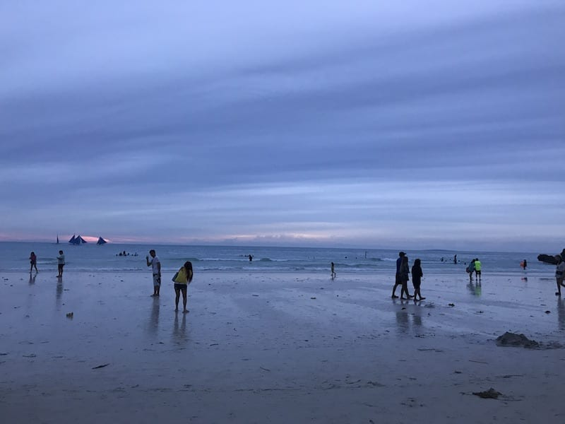 Smooth blue tinted cloud over the sky at sunset at Boracay Station 1 beach during the typhoon season | Is Boracay worth going in the rainy season?