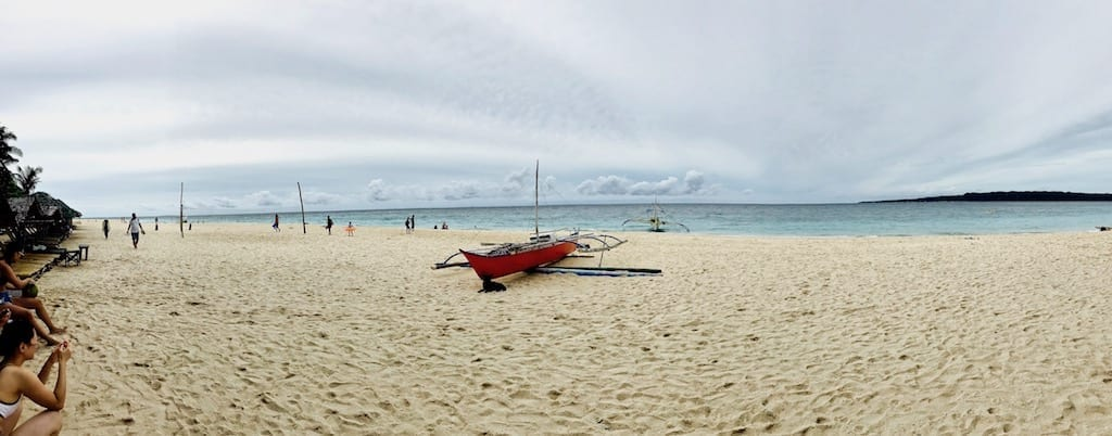 A view along the sandy Puka beach looking towards the sea | Boracay island hopping tour