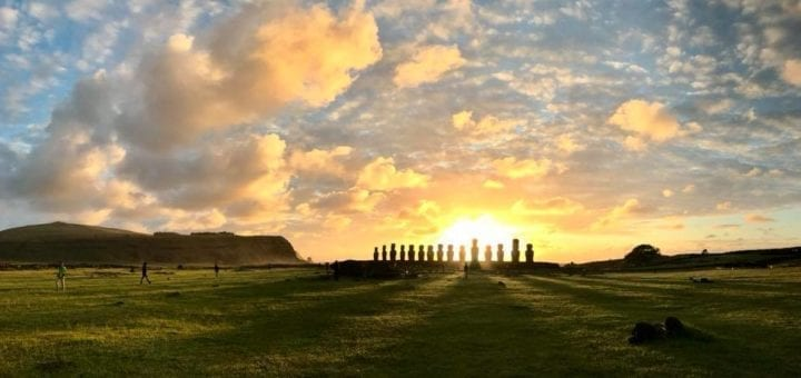 Sunrise streaming in between moai in silhouette at Ahu Tongariki in Easter Island, Chile | Isla de Pascua