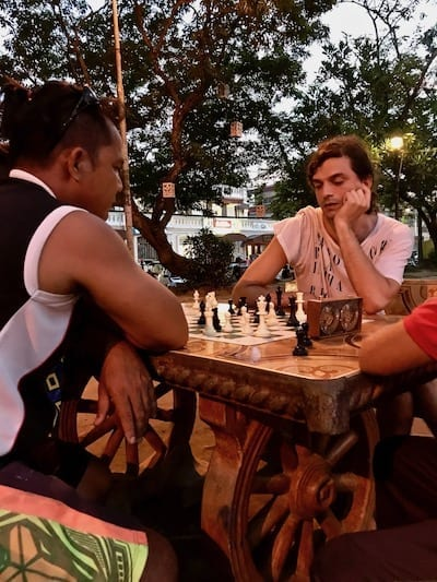 Jason at the chess table playing against a local Ilocano in Plaza Burgos, Vigan | Unexpected things to do in Vigan